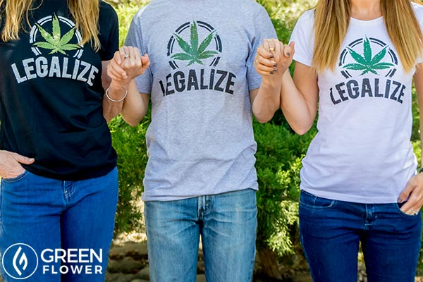 People wearing Legalize Cannabis t-shirts and holding hands
