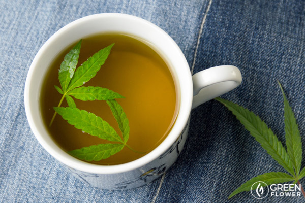 Cannabis leaf floating inside cup of tea