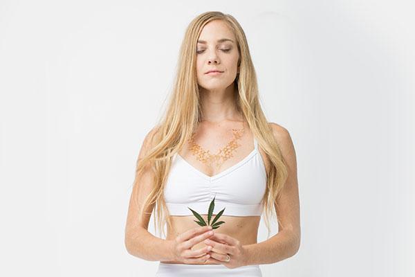 Rachael Carlevale holding a cannabis leaf