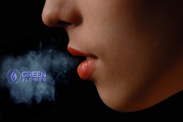 Woman exhaling cannabis vapor