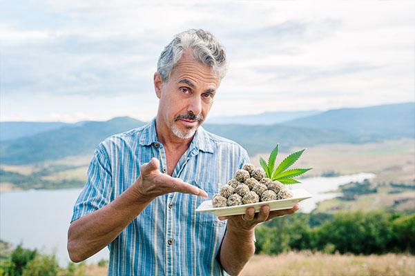 Chris Kilham holding a plate of majoon balls