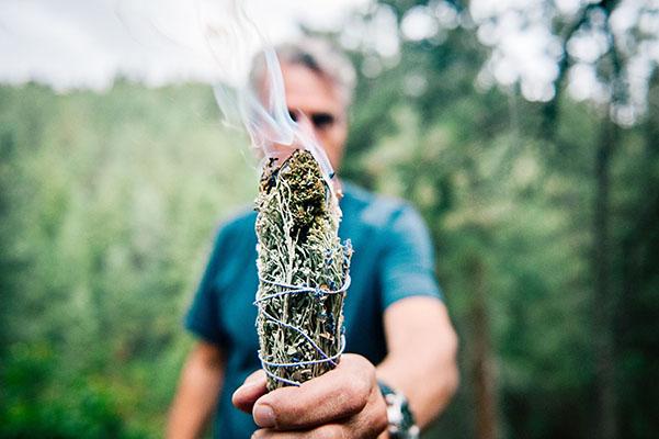Chris holding a cannabis smudge stick