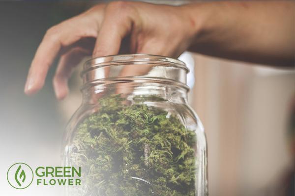 Hand in the cannabis jar