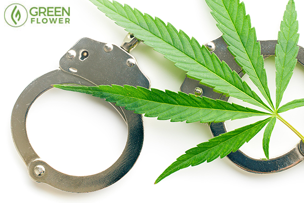 Cannabis leaf and handcuffs