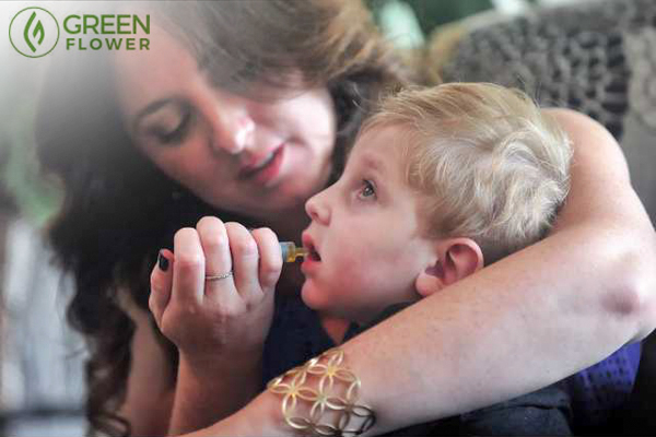 Mother giving child medical cannabis