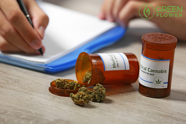 writing on pad near medical cannabis