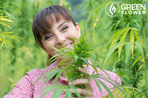 girl smiling with cannabis plant