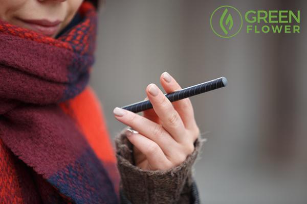 lady holding vape pen