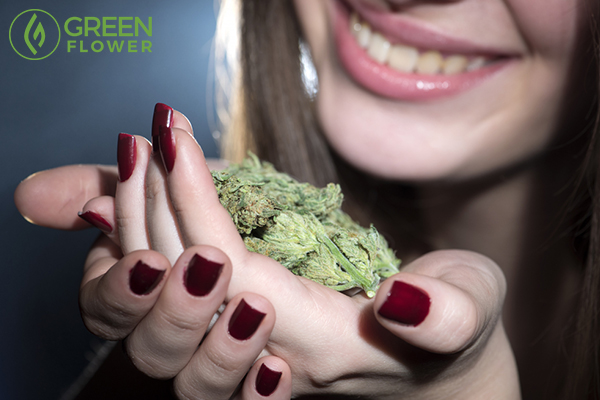 smiling lady with cannabis buds