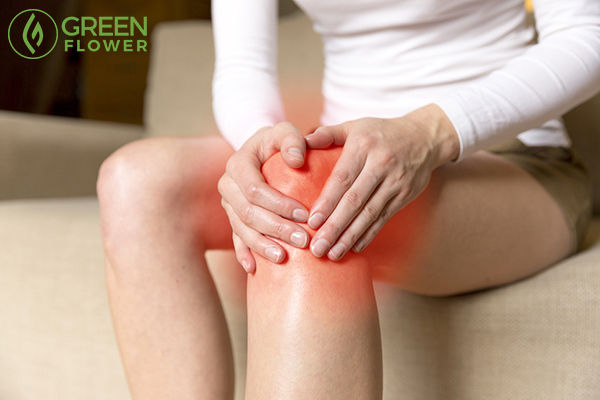 young woman massaging her painful knee