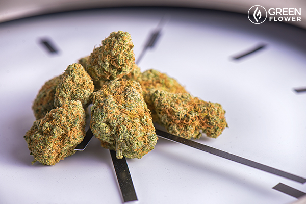 cannabis on wall clock